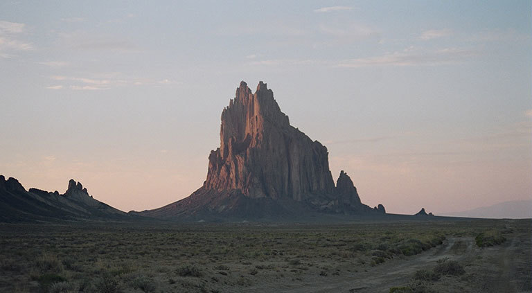 "Shiprock, New Mexico, is in the Four Corners region where an atmospheric methane ""hot spot"" can be seen from space. Researchers are currently in the area, trying to uncover the reasons for the hot spot. Credit: Wikimedia Commons. View larger image."