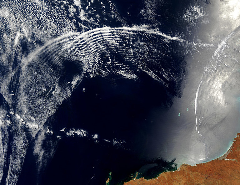 Two unique types of waves ripple through the Indian Ocean in this spectacular true-color Moderate Resolution Imaging Spectroradiometer (MODIS) image, taken by the Terra satellite on November 11, 2003. Credit: Jacques Descloitres, MODIS Rapid Response Team, NASA/GSFC. Learn more about and download the image.