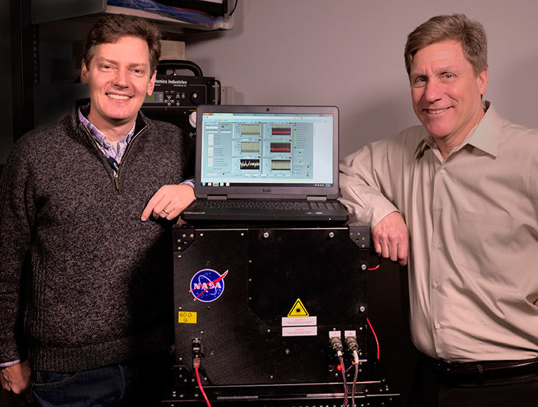 Goddard scientists Tom Hanisco (left) and Paul Newman (right) serve as science team co-investigators on NASA's newest Earth Venture mission, the Atmospheric Tomography Mission (ATom). One of ATom's instruments is a device (pictured here) that Hanisco developed to measure formaldehyde more efficiently. Credit: Bill Hrybyk/NASA. View larger image.