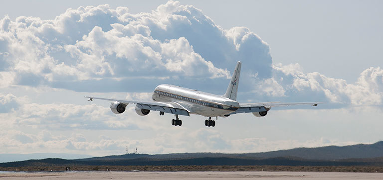 NASA's DC-8 aircraft takes off from its base operations in Palmdale, California, on a mission aimed at studying polar winds in the Arctic region. Credit: NASA Photo / Carla Thomas. View larger image.