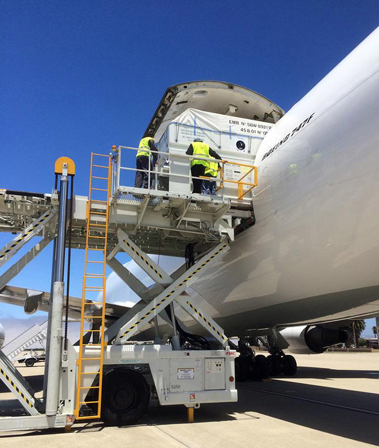 The Jason-3 spacecraft is unloaded from a 747 transport aircraft at Vandenberg Air Force Base, California, on June 18, 2015, concluding a journey from the Thales Alenia Space manufacturing facility in France. The Jason-3 satellite altimetry mission is scheduled to launch this August. Credits: NASA