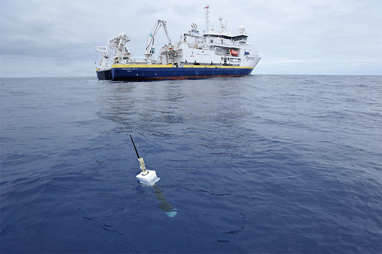 An Argo float, foreground. The new study included direct measurements of ocean temperatures from the global array of 3,500 Argo floats and other ocean sensors. Credit: Argo program, Germany/Ifremer. View larger image.