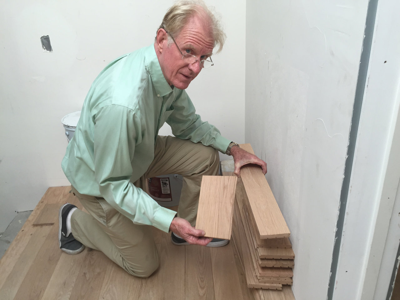 Ed Begley Jr. inspects his oak hardwood flooring, which is 100 percent sourced from old barns and buildings.