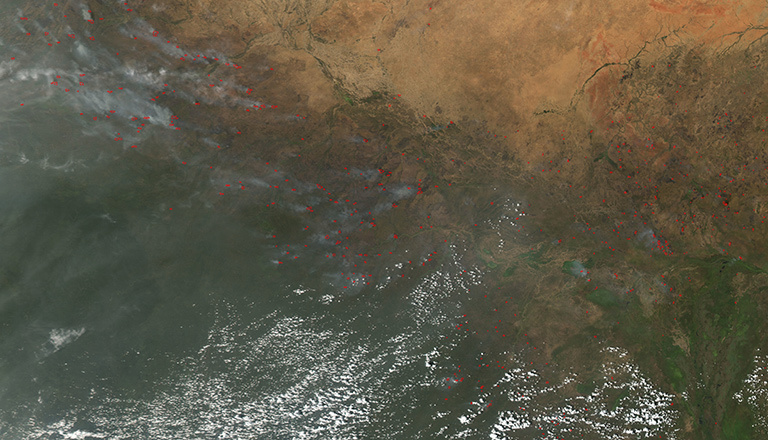 The Moderate Resolution Imaging Spectrometer (MODIS) instrument on NASA's Aqua satellite captured this image of numerous fires burning in the transition zone between the Sahara Desert to the north and the greener savannas to the south. The image, dating from November 2004, includes parts of Sudan, Chad and other nations to the south and west. Credit: NASA. View larger image.