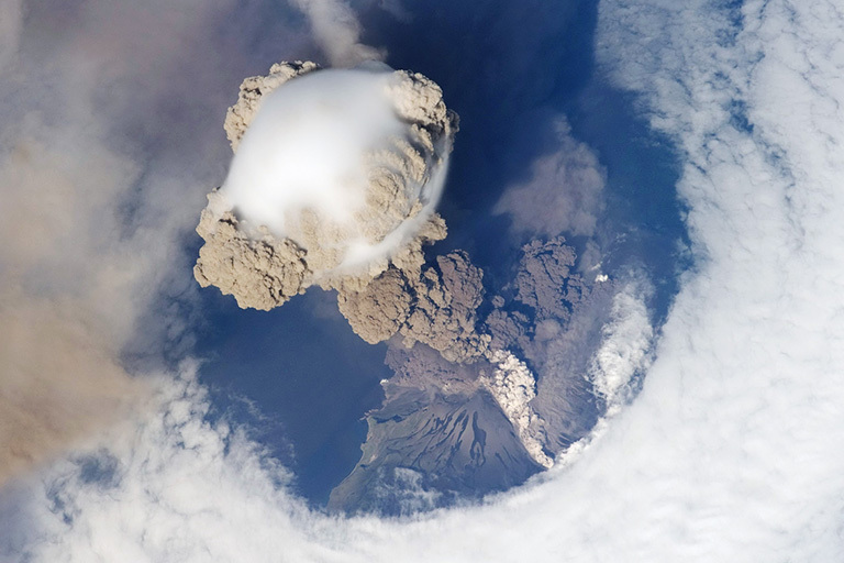 This is a plume of ash from the Sarychev volcano in the Kuril islands, northeast of Japan. The picture was taken from the International Space Station during the early stage of the volcano's eruption on June 12, 2009. Credit: NASA. Full caption. View larger image.
