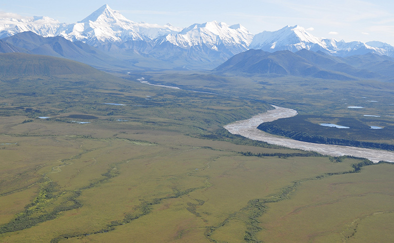NASA's ABoVE campaign will combine field work, airborne surveys, satellite data and computer modeling to study the effects of climate change on Arctic and boreal ecosystems, such as this region at the base of the Alaska Range south of Fairbanks. Credit: NASA/Ross Nelson. View larger image.