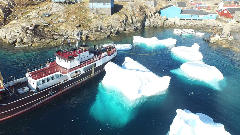 The M/V Cape Race at Kullorsuaq, Greenland, picks up fresh drinking water. Credit: Justin Fenty
