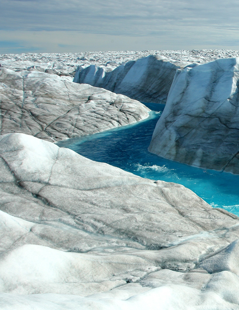 A river flows in the western region of the Greenland Ice Sheet.