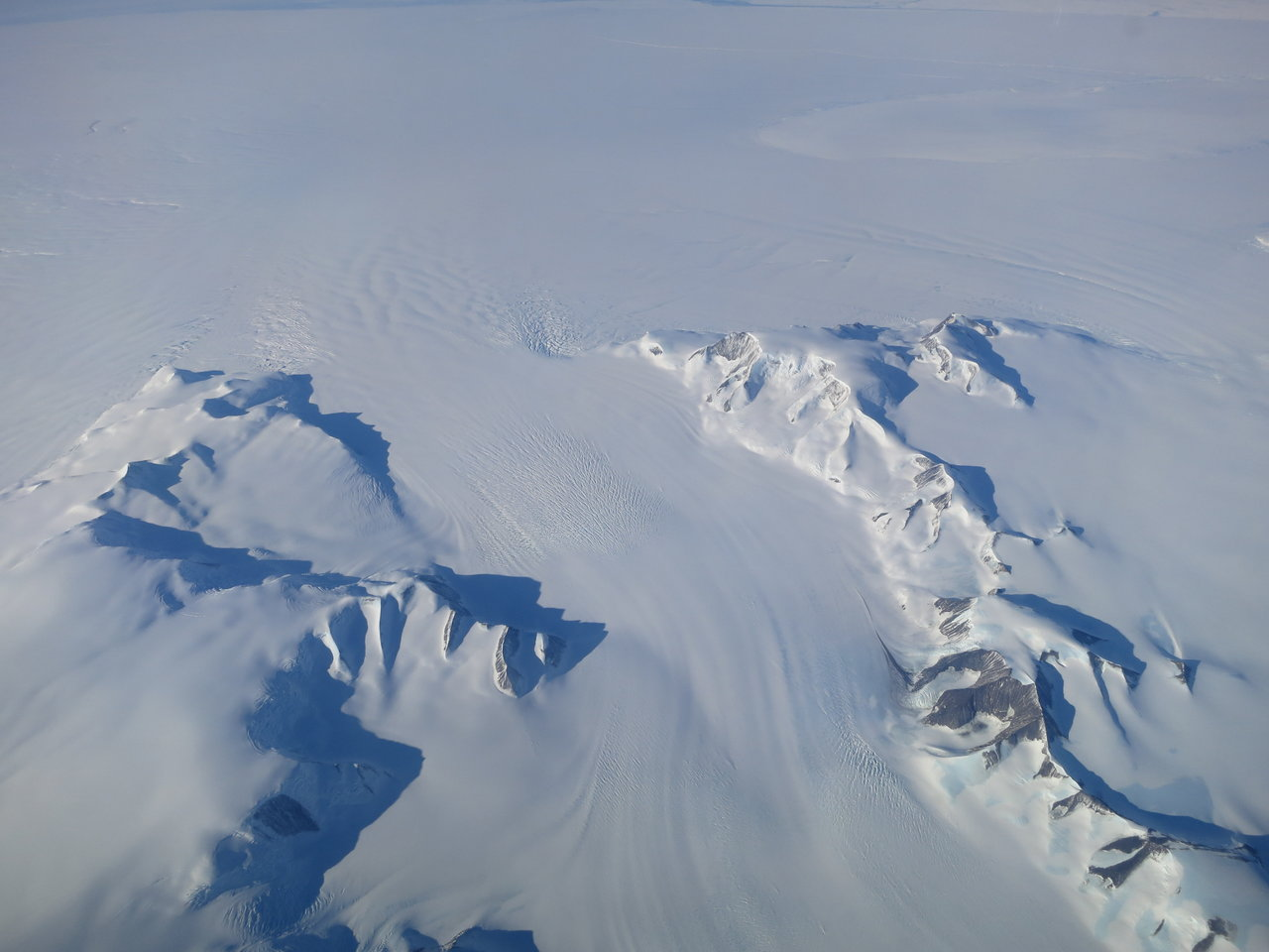A new NASA study says that Antarctica is overall accumulating ice. Still, areas of the continent, like the Antarctic Peninsula photographed above, have increased their mass loss in the last decades. Credit: NASA's Operation IceBridge.
