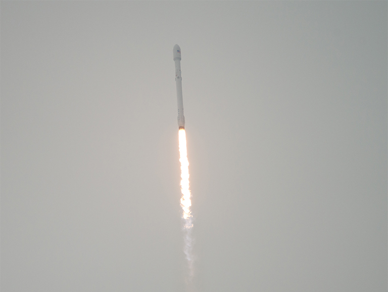 A SpaceX Falcon 9 rocket launches from Vandenberg Air Force Base.