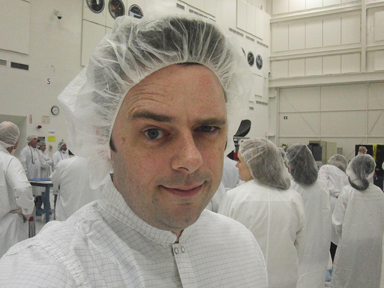 Dr. Josh Willis, lead project scientist for the Jason-3 mission, wears a bunny suit in JPL's clean room where the instrument was built.