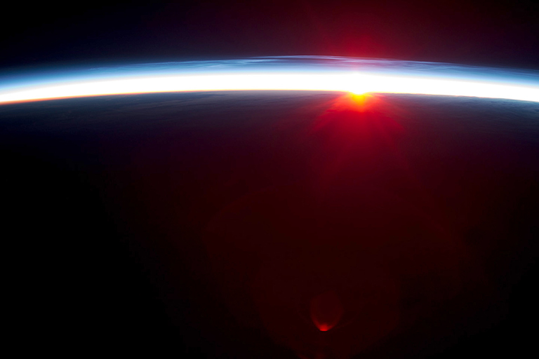 Earth's atmosphere viewed from the International Space Station. A NASA/Duke University study provides new evidence that natural cycles alone aren't sufficient to explain the global atmospheric warming observed over the last century. Credit: NASA.