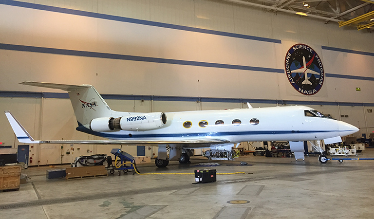 One of NASA's modified G-III aircraft in the hangar at Armstrong Flight Research Center being prepped for a mission to study glaciers around Greenland.