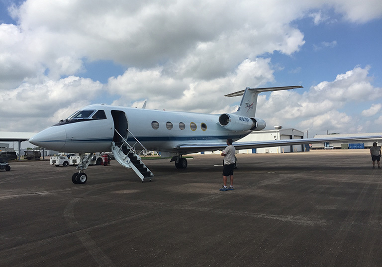 NASA's modified Gulfstream-III on the runway at Ellington Field Airport in Houston, Texas, with OMG scientists and engineers aboard.