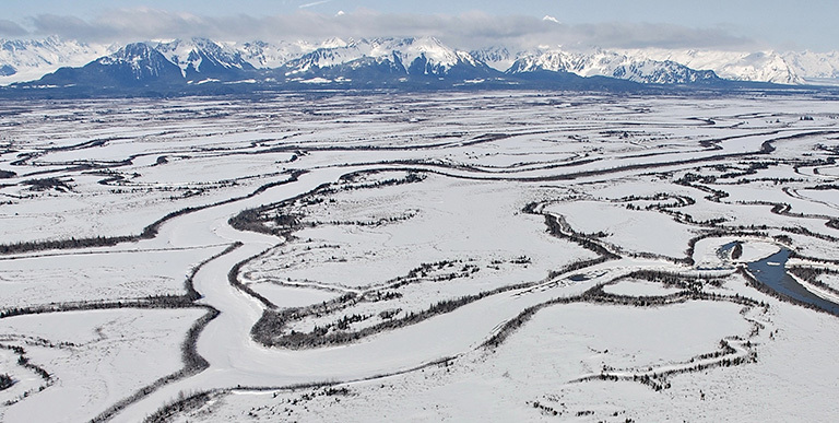 Even after the ground surface freezes in the fall, Alaskan soils can continue to emit carbon.