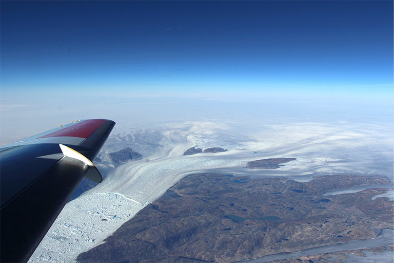 A photo taken over a glacier in Greenland from a NASA plane.