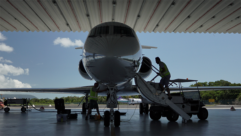 A photo nose-on of NASA's Gulfstream III jet in its hangar.