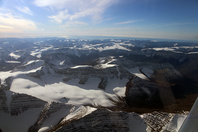 Flying low over Greenland's coastline in NASA's modified G-III aircraft