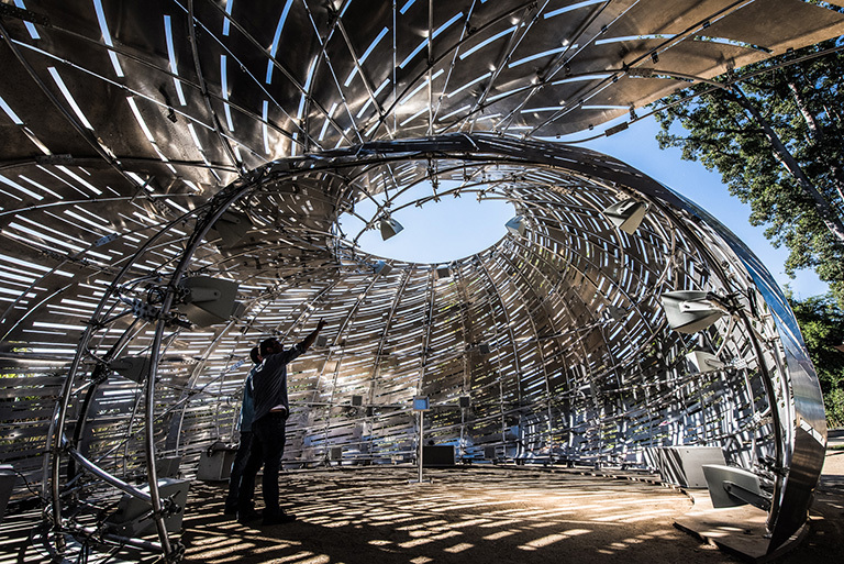 Visitors inside the Orbit Pavilion, a sound installation designed to teach the public about NASA's earth science satellites. The installation was designed at JPL and opens to the public at The Huntington Library, Art Collections & Botanical Gardens on Oct. 29, 2016. Credit: NASA/JPL-Caltech.
