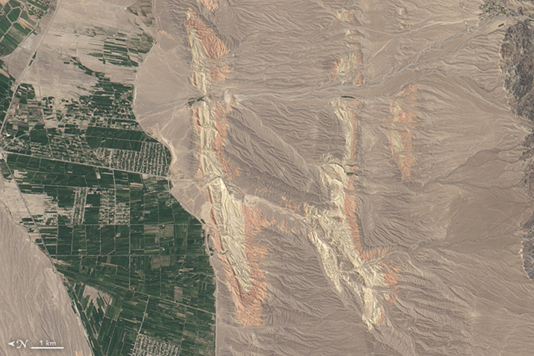 """H"" is for Home. On, August 30, 2014, the Operational Land Imager on Landsat 8 acquired this image of rivers running through colorful ridges in southwestern Kyrgyzstan."