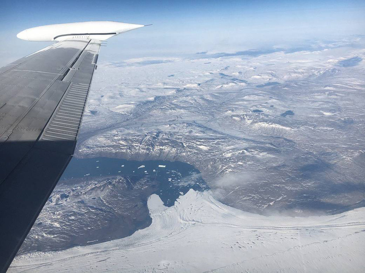 This photograph was taken on Aug. 29, 2017, from 28,000 feet, looking north while surveying Nioghalvfjerdsbrae (79 N) Glacier in northeast Greenland.