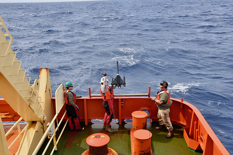 The crew prepares to deploy the radiometer from the stern of the R/V Nathaniel Palmer to measure the optical properties of the water from the surface down all the way down to the bottom of the photic zone. Credit: Lena Schulze/FSU.