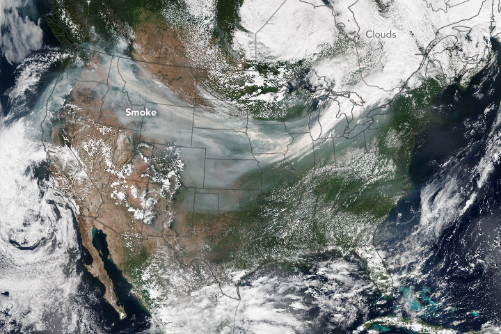 A smoke plume spans the United States. NASA Earth Observatory image by Jesse Allen, using VIIRS data from the Suomi National Polar-orbiting Partnership.