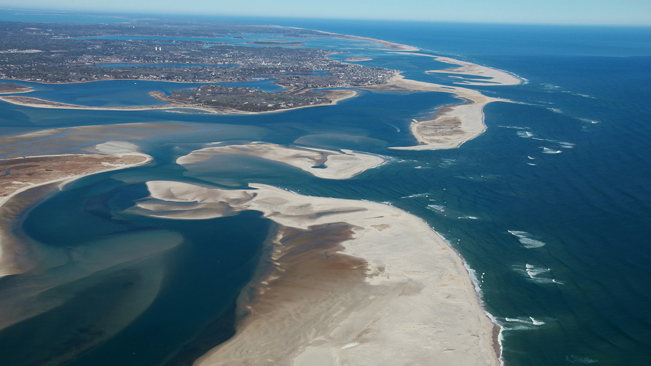 Sandbars surrounded by ocean.