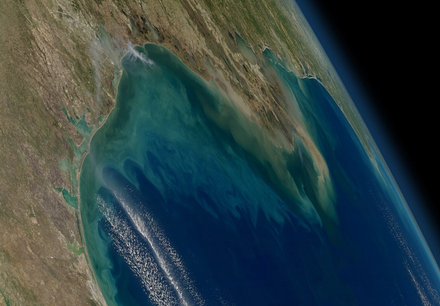 NASA's Geosynchronous Littoral Imaging and Monitoring Radiometer (GLIMR) instrument will collect high-resolution observations of coastal ecosystems in such areas as the northern Gulf of Mexico, shown in this image with phytoplankton blooms stretching from the Texas and Louisiana coast (left) across the Mississippi River delta (center) toward Florida (far right). Credit: NASA