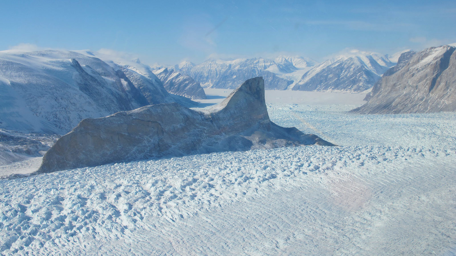The Kangerdlugssup (pictured) and Jakobshavn glaciers in Greenland have lost roughly 14 to 20 feet (4 to 6 meters) of elevation per year over the past 16 years. Credit: NASA/Jim Yungel › Larger view