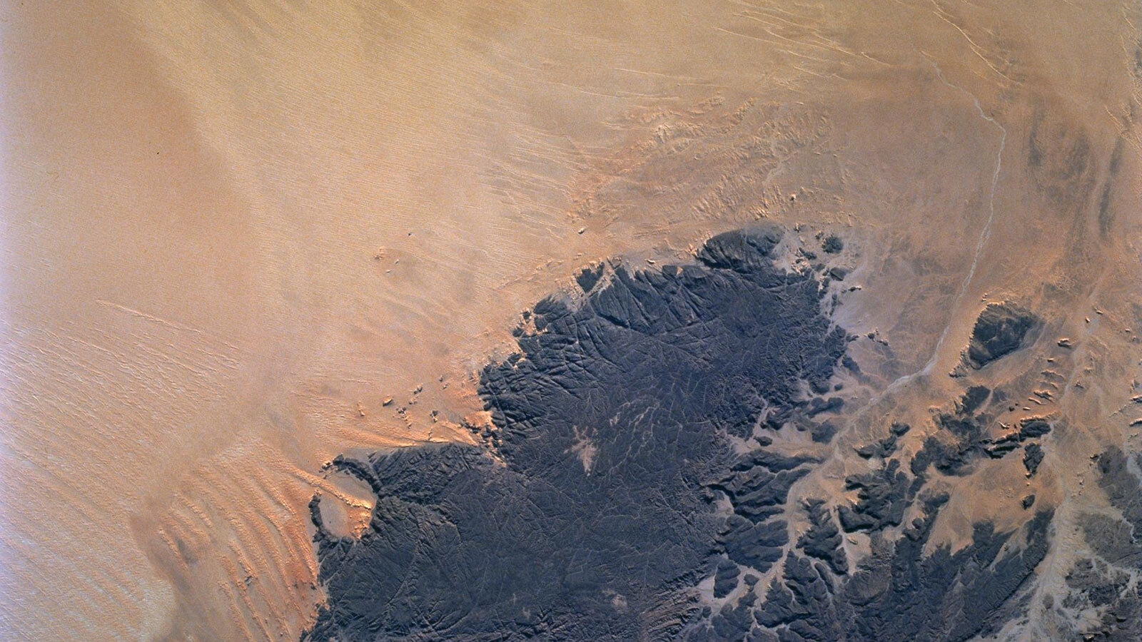 Deserts like the Sahara harbor freshwater aquifers that can be affected by Earth's changing climate. The OASIS study project seeks to establish a mission that would find and examine those aquifers.