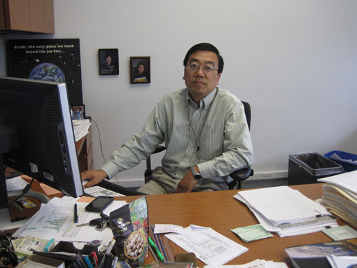 Yi in his office