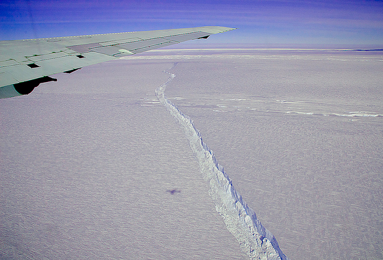 A photo from the window of NASA's DC-8 shows the rift across the Pine Island Glacier ice shelf running off toward the horizon.Credit: Michael Studinger/NASA