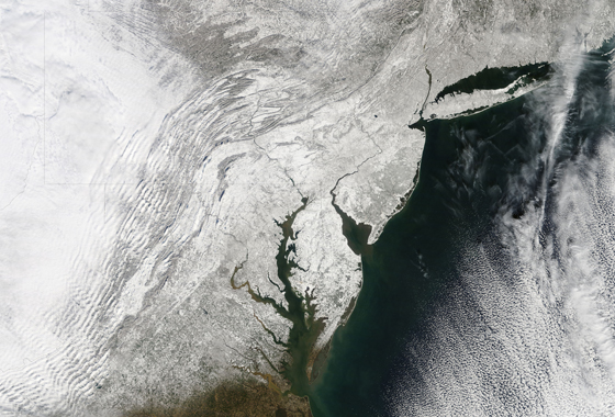 A blocking event over Greenland led to intense blizzards in the East Coast of the United States in February 2010. The Moderate Resolution Imaging Spectroradiometer (MODIS) on NASA's Terra satellite captured this true-color image on February 11, 2010, after a second snow storm had hit the East Coast in less than a week. Credit: NASA MODIS Rapid Response Team/Jeff Schmaltz.