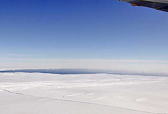 A large, miles-long crack was plainly visible across the ice shelf on the Pine Island Glacier during an overflight by NASA's DC-8 airborne science laboratory on Oct. 14, 2011, as part of Operation IceBridge, one of a number of NASA airborne Earth science missions flying in 2012. Credit: NASA/Michael Studinger.