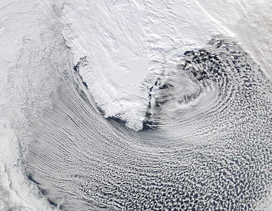 Cloud streets around southern Greenland. Image taken by NASA's MODIS (Moderate Resolution Imaging Spectroradiometer) instrument onboard the Aqua satellite.