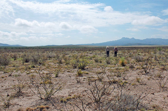 Two ranchers walk across the plains of drought-stricken West Texas in July 2011. (Photograph courtesy U.S. Department of Agriculture.)