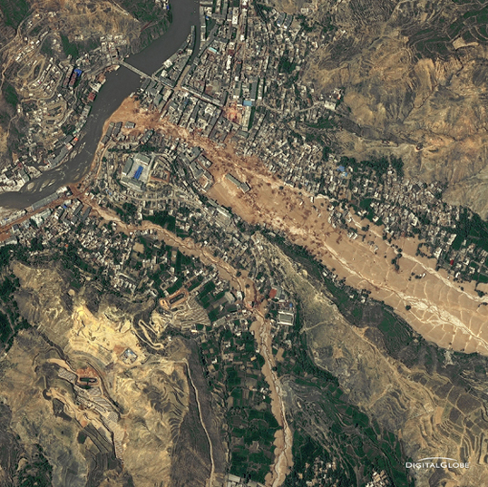 Around midnight on Aug. 8, 2010, a violent surge of loosened earth roared down mountain slopes and slammed into quietly sleeping neighborhoods in Zhouqu County in Gansu, China. The catastrophic mudslides -- the deadliest in decades according to state media -- buried some areas under as much as 23 feet (7 meters) of suffocating sludge. 1,765 people died. Property damages totaled an estimated $759 million. Cutting from right to left, this detailed image, from DigitalGlobe's WorldView-2 satellite, shows the largest slide in the lower part of the city on Aug. 10, 2010.