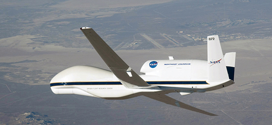 NASA's Global Hawk remotely operated Earth science aircraft No. 872 banks right over Edwards Air Force during a checkout flight. (NASA / Carla Thomas)
