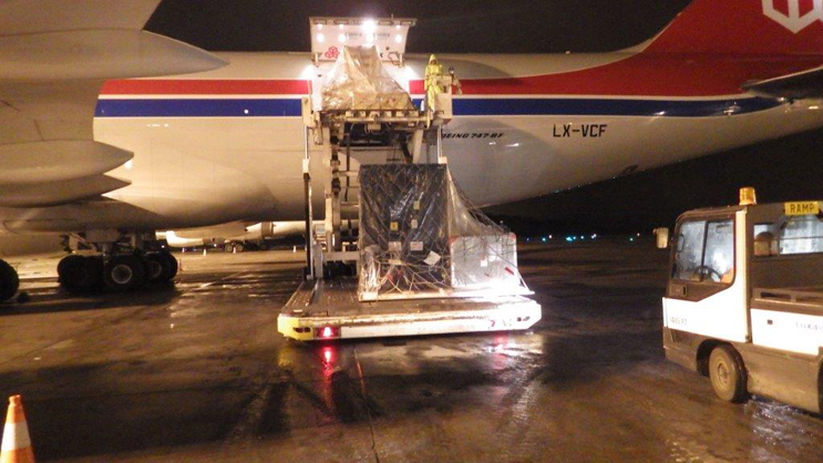 The three NASA-built instruments and associated ground support equipment for the U.S./European Jason-3 ocean altimetry satellite are removed from a Cargo Lux 747-800 transport plane in Luxembourg on May 21, 2013, following a transatlantic flight. Image credit: NASA/JPL-Caltech