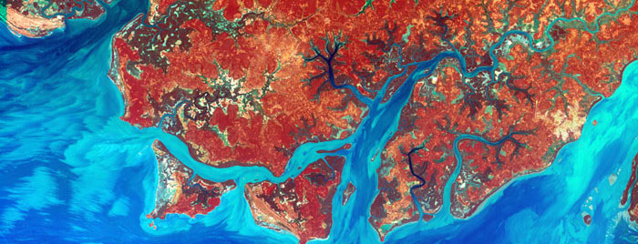 GUINEA-BISSAU COAST: Guinea-Bissau is a small country in West Africa. Complex patterns can be seen in the shallow waters along its coastline, where silt carried by the Geba and other rivers washes out into the Atlantic Ocean. Image taken by Landsat 7 on December 1, 2000.